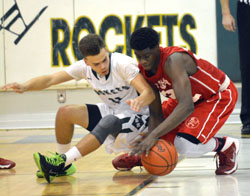 New haven's #11 Joshua Mills and Mt. Clemens' #32 battle for loose ball.
